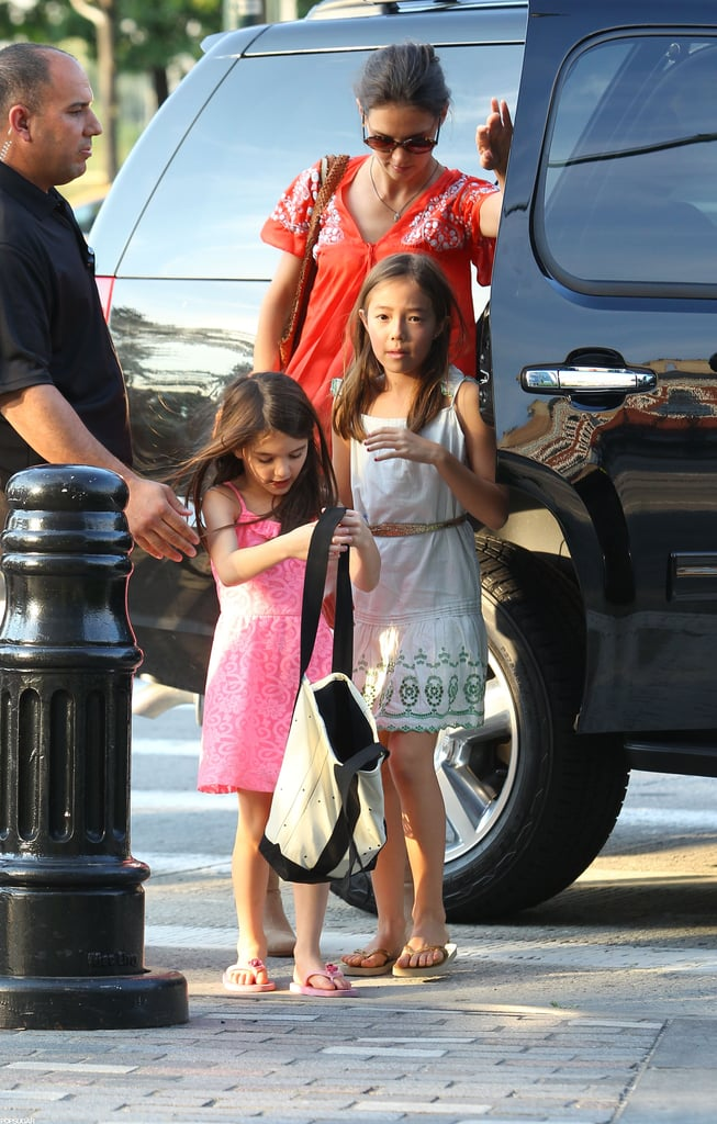Suri Cruise carried her athletic clothes in a bag.
