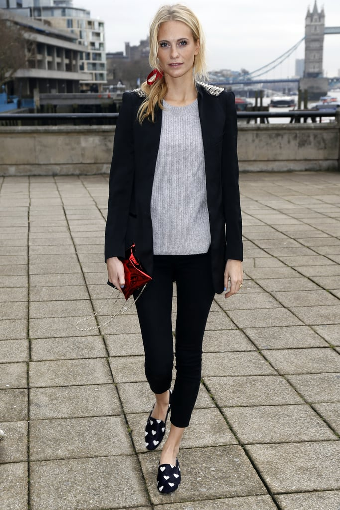Poppy Delevingne put together a cute outfit in London that'd be beyond easy to re-create. Mix a gray sweater with skinny-cut trousers and a blazer, add printed smoking slippers, and finish with a ribbon in the hair. Adorable!