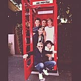Ellen DeGeneres posed in an English-style phone booth with the boys of One Direction. Source: Twitter user TheEllenShow