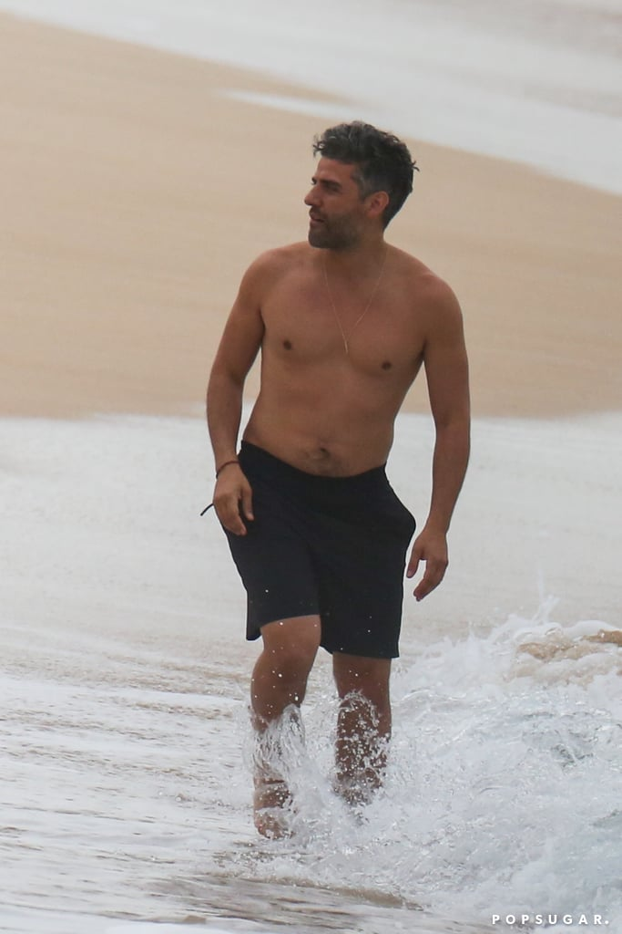 Oscar Issac looked all kinds of sexy when he hit the beach in Hawaii with Ben Affleck, Charlie Hunnam, and Garrett Hedlund. The actors — who are currently training for the upcoming Netflix film Triple Frontier — were photographed snorkeling, bodyboarding, and playing with underwater scooters in the ocean, but we were too distracted by Oscar's perfectly bronzed body to even notice. I mean, we already knew that Oscar is extremely good-looking, but seeing him shirtless just takes our love for him to a whole new level. Am I right?  The action-adventure film centers around the border between Brazil, Paraguay, and Argentina and is expected to debut on Netflix sometime in 2019. Luckily, we have these mouthwateringly hot photos to hold us over until then. Consider this our weekend gift to you.       Related:                                                                                                           Is Oscar Isaac Married? Here's What We Know About His Love Life