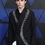 Timothée wore an unconventional, stand-up collar Haider Ackermann blazer to the Governors Awards in 2018.