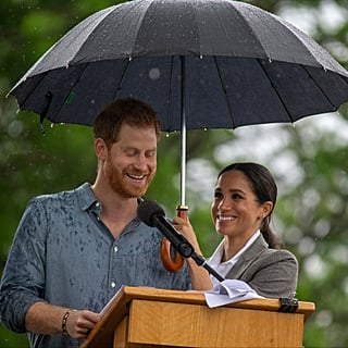 Meghan Markle Holding Prince Harry's Umbrella October 2018