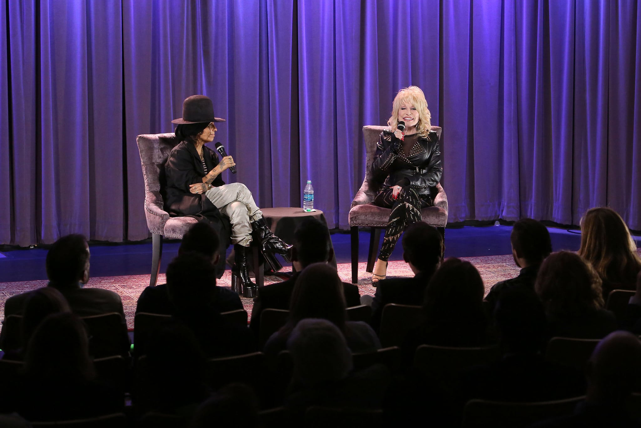 LOS ANGELES, CALIFORNIA - FEBRUARY 04: Linda Perry and Dolly Parton speak onstage during the GRAMMY Museum Town Hall Program With Dolly Parton Moderated By Linda Perry at The GRAMMY Museum on February 04, 2019 in Los Angeles, California. (Photo by Jesse Grant/Getty Images)