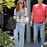 She Wore an Embroidered White Blouse With Lightwash Jeans