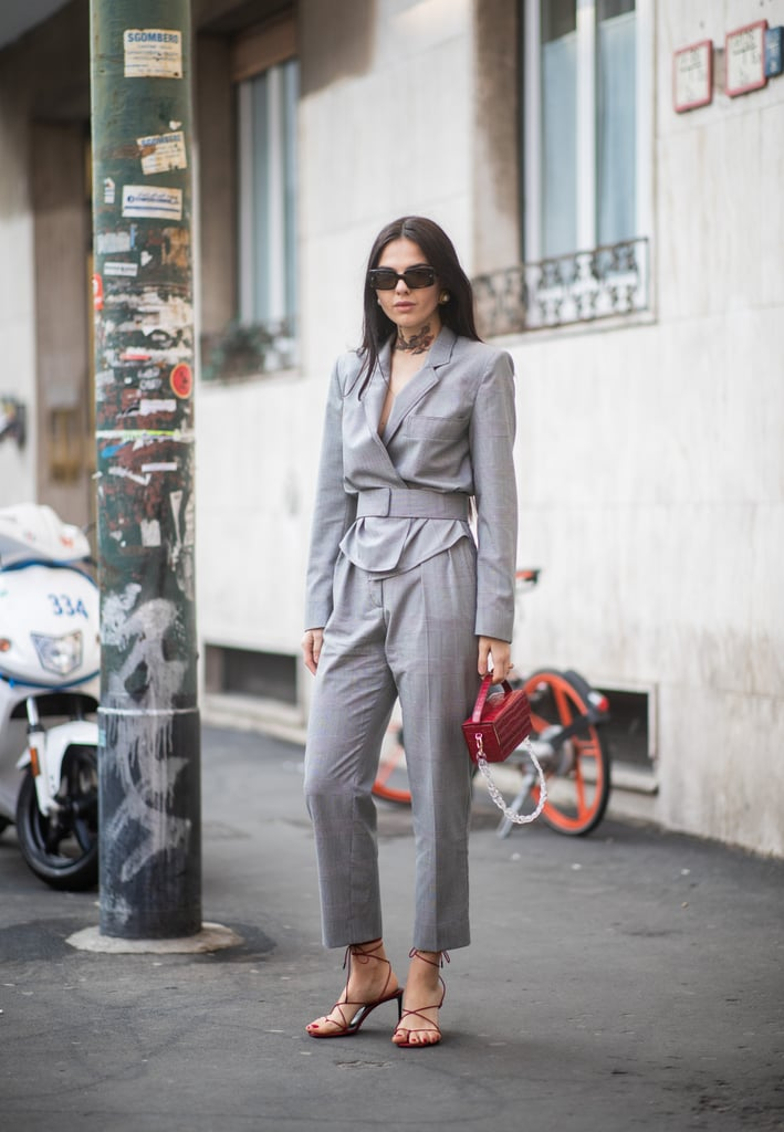 Suit up in a gray look, black sandals, and matching sunglasses.
