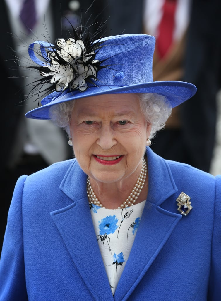 The queen wore a hat and suit in her signature blue at the derby.