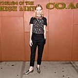 Kate Bosworth played it smart-casual in head-to-toe Coach, adding interest with a floral-print tee and metallic loafers.