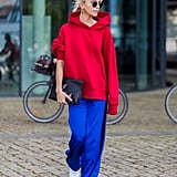 Put On Your Track Pants and Hoodie With Statement Earrings and White Booties