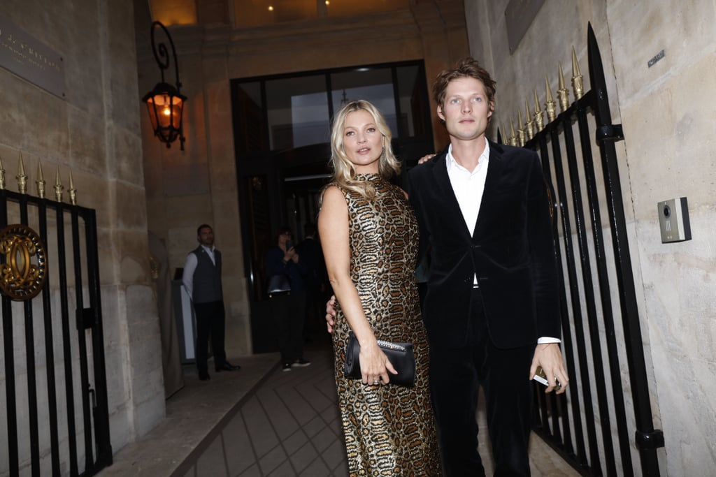 Kate Moss and photographer Nikolai von Bismarck began quietly dating in 2016, a year after Kate ended her marriage to rocker Jamie Hince. The couple went public the summer of that year when they attended the launch of Kate's collaboration with Equipment, where they were spotted holding hands on their way to the event and posed for photos once inside. Since then, they're constantly spotted sitting front row at fashion week in London and Paris (sometimes with Kate's daughter Lila tagging along) and hanging out in London. While they haven't made a ton of public appearances together over the past four years, when they do, it's clear that they not only have a lot of fun together — whether they're smiling or smizing — but that Moss's fashion know-how has also definitely rubbed off on Nikolai. See their cutest pictures together ahead.