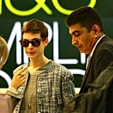 Anne Hathaway wore sunglasses at Heathrow.