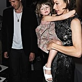 Milla Jovovich carried her daughter, Ever Anderson, as her husband, Paul W.S. Anderson, stayed close by her side.