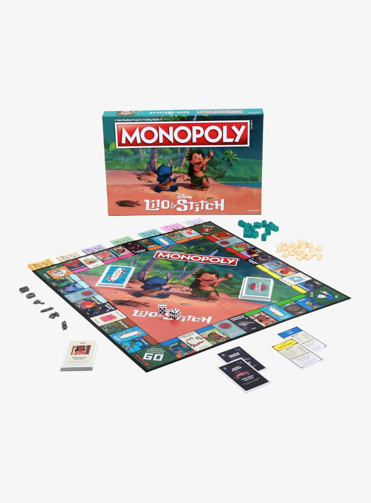 "There's no place I'd rather be than at home on the couch having a Disney-themed game night with friends and family, and this Lilo & Stitch Edition Monopoly Board  ($49) from Hot Topic just made my list of ""games I must play ASAP, or else I'll be forced to lay on the floor and listen to sad Elvis tunes on repeat."" Available at Hot Topic, the board is a perfect combo of all things tropical and intergalactic, and it features some of my favourite characters from the films — including Nani, David, Jumba, Pleakley, Cobra Bubbles, and Pudge the Fish. So cute! Instead of collecting property, the object of this Monopoly game is to buy, sell, trade, and collect your favourite experiments, so dibs on 625, AKA Reuben! Best of all, each pawn is based off a memorable moment from the original film. This means you can play as Lilo's record player, her camera, her handmade doll Scrump, a plumeria flower, a surfboard, or a mini palm tree as you work with the Galactic Federation to save all of Stitch's mutated cousins. If this sounds like your kind of adventure, you can shop the adorable Lilo & Stitch-inspired board game ahead."