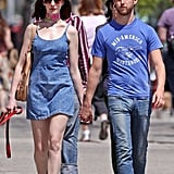 Anne Hathaway and Adam Shulman took a walk in NYC during April 2009 with their dog.