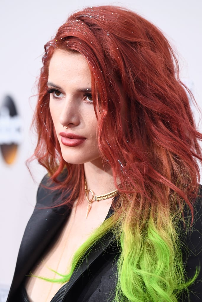 Earlier this week, Bella Thorne and her older sister Dani debuted matching rainbow hair, and they just brought their striking 'dos to the red carpet on Sunday night at the 2016 American Music Awards. Channeling their inner Lisa Frank, My Little Pony, and, yes, an Astro Pop, the Thorne sisters showed off red, yellow, and green ombré hair.   The 19-year-old Disney star decided to add glitter to the top of her head, making the volumized look even more dramatic than before. While Bella kept her makeup relatively low-key, her hair stole the show (no shirt necessary)! Keep reading to see some of the gorgeous photos of Bella and her sister Dani at the 2016 American Music Awards, and then see all the stunning beauty looks from the show.      Related:                                                                Bella Thorne and Her Sister Dani Try Out the Rainbow Hair Trend                                                                   Zoom In on Every Smoldering Look From the American Music Awards