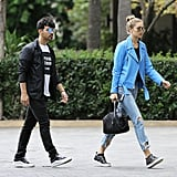 When Joe Wore Sunglasses That Reflected the Electric Color of Gigi's Moto Jacket