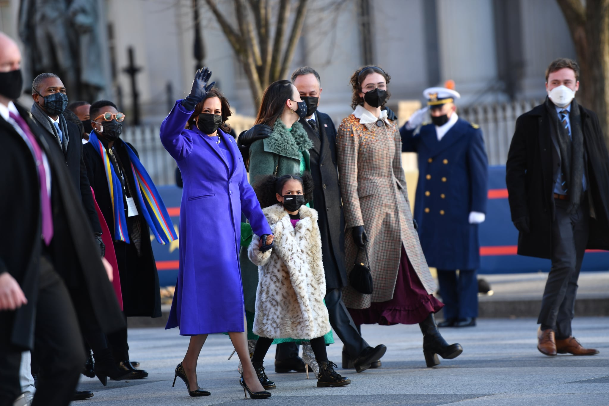 WASHINGTON, DC - JANUARY 20: U.S. Vice President Kamala Harris, husband Doug Emhoff, her great niece Amara, and family members walk the abbreviated parade route after U.S. President Joe Biden's inauguration on January 20, 2021 in Washington, DC. Biden became the 46th president of the United States earlier today during the ceremony at the U.S. Capitol. (Photo by Mark Makela/Getty Images)