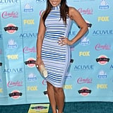 Jordin Sparks got the turquoise carpet off to an early start in a striped formfitting Bebe sheath and Swarovski clutch.