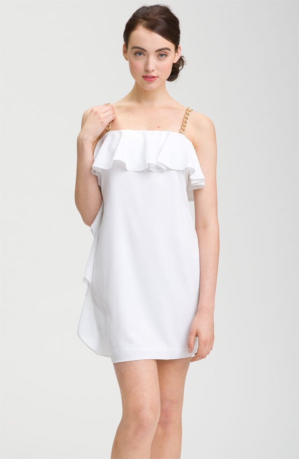 A cocktail silhouette can be just as glam with pretty ruffles and chain straps.  Calvin Klein Chain Strap Ruffle Cocktail Dress ($138)