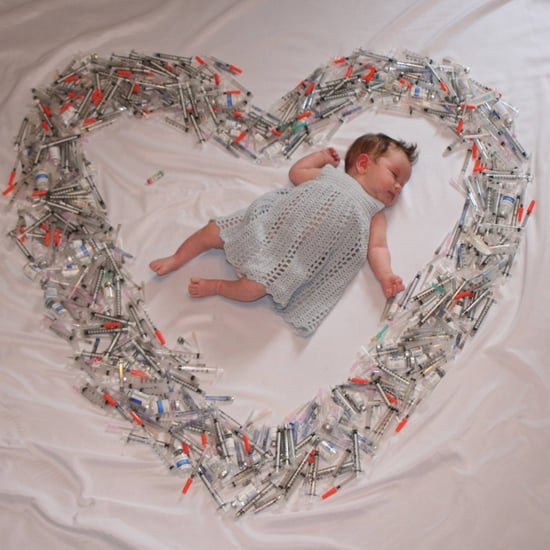 Photo of Baby Surrounded by Syringes