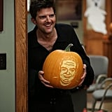 Parks and Recreation Adorable Ben (Adam Scott) shows off a carved pumpkin on the Halloween-themed episode, sadly not airing until Nov. 21.