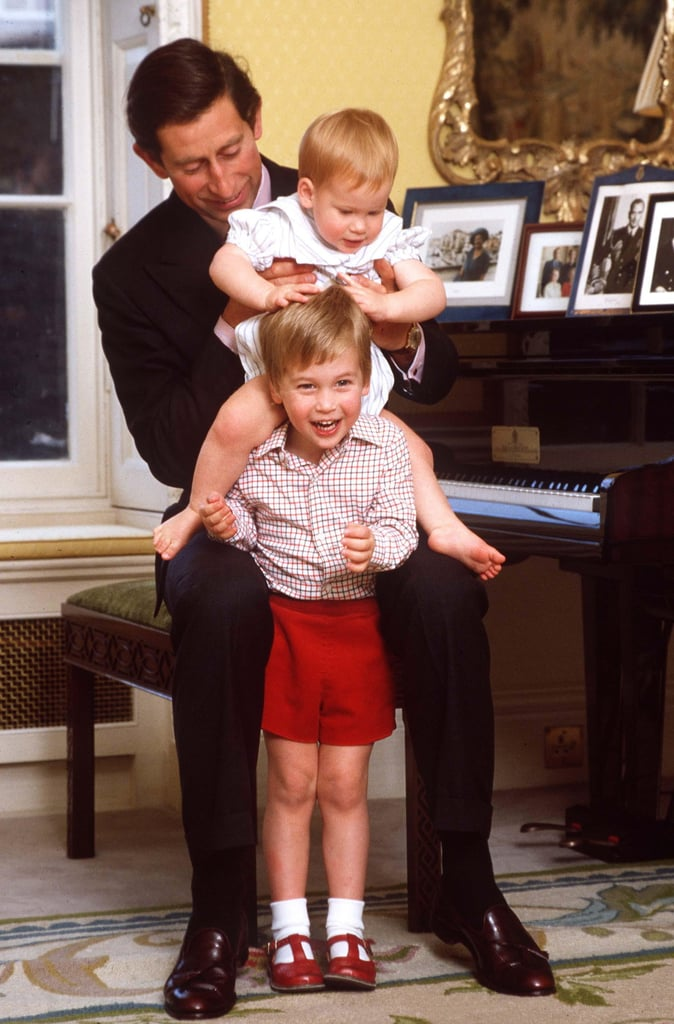 Prince Charles played with Prince William and Prince Harry at Kensington Palace in October 1985.