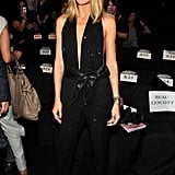 Heidi Klum in a black jumpsuit.