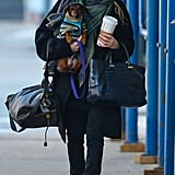 Ashley Olsen layered up in all black and a plaid scarf while walking with her pup in NYC. Oversized round sunglasses and a The Row bag completed her cold-weather style.
