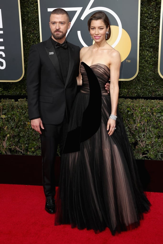 "Justin Timberlake and Jessica Biel led by example when they showed up wearing all black to the Golden Globe Awards in LA on Sunday. Jessica stunned in a strapless floor-length gown, while Justin cut a suave figure in a matching tux. The couple are just two of the many stars wearing all-black looks as a symbol of protest against sexual harassment in the industry. Prior to arriving at the ceremony, Justin posted a selfie of him and Jessica getting ready on Instagram, writing, ""Here we come!! And DAMN, my wife is hot!#TIMESUP #whywewearblack."" It's a big night for the pair, as Jessica is nominated for best performance by an actress in a limited series for her leading role in The Sinner and Justin is celebrating the recent release of his single, ""Filthy."""