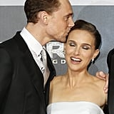Tom surprised Natalie Portman with a peck.