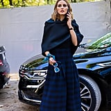Olivia Palermo's cape just upped the drama on this look.