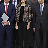Queen Letizia's bolero jacket had elevated textures, interesting colors, and patterns throughout. She wore the piece to a meeting at Madrid's Zarzuela Palace in December 2015.