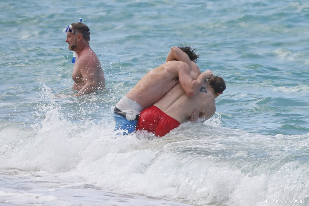 Charlie Hunnam and Garrett Hedlund Wrestle in Hawaii Photos