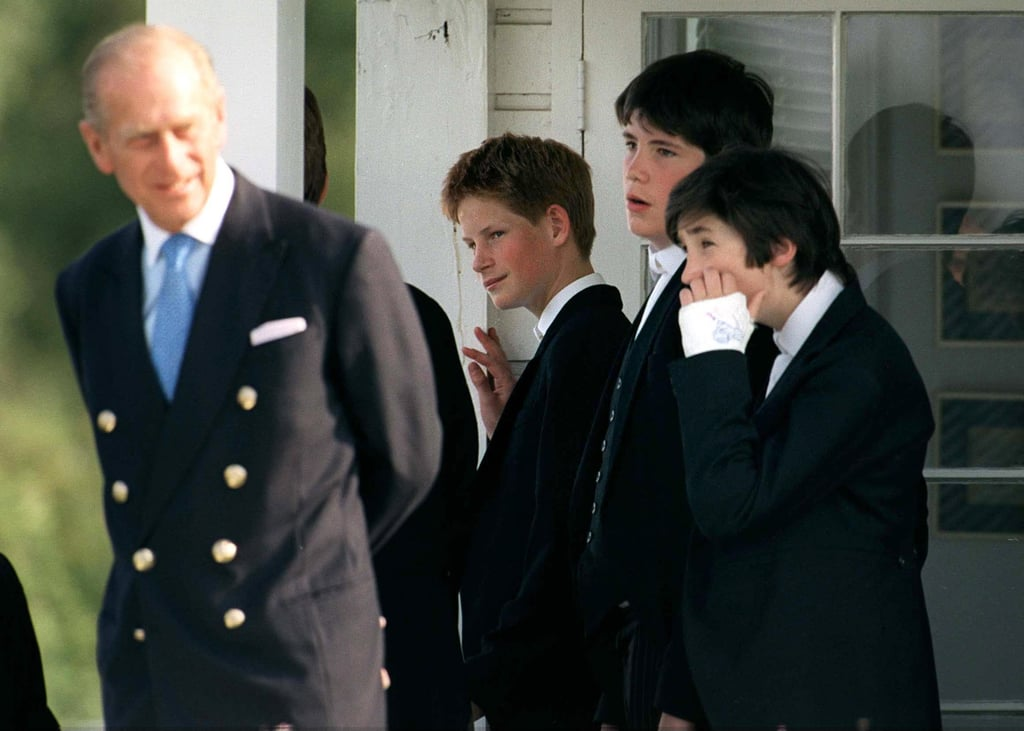 At the Eton Boy's tea party in Windsor in June 1999, a 14-year-old Harry looked proudly at his grandfather.