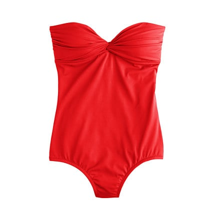 This red-hot one-piece is for the beach-bound siren.  J.Crew Twist Bandeau Tank ($82)