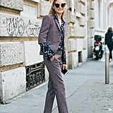 Hack: Give your printed suit set '60s appeal by layering it over a geometric top. Jacquard loafers in the same shade balance out everything.