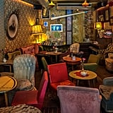 Now if cocktails and eclectic vibes are more of your scene, you're going to adore Cafe Brecht. From the retro vintage vibe to the faded furnishings and era-appropriate wallpaper, you will instantly feel as if you've traveled back in time. This Berlin-style bar is definitely worth a visit, not to mention the craft cocktails are quite satisfying, too.