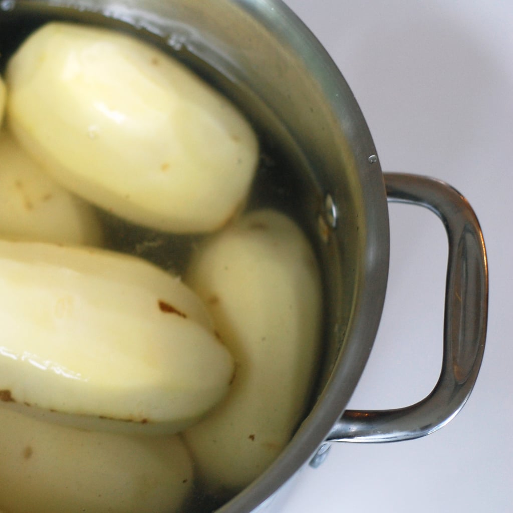 Adding your potatoes to boiling water.