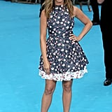 To premiere We're The Millers in London, Jennifer Aniston took a break from her signature look and did a flirty, floral print cotton and silk frock instead.