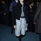 For her arrival at Nina Ricci, Olivia mixed in a peppy print with her textured pencil skirt and furry topper.
