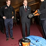 Harry introduced a group of Walking With the Wounded challenge participants to his grandfather at a Buckingham Palace reception in November 2013.