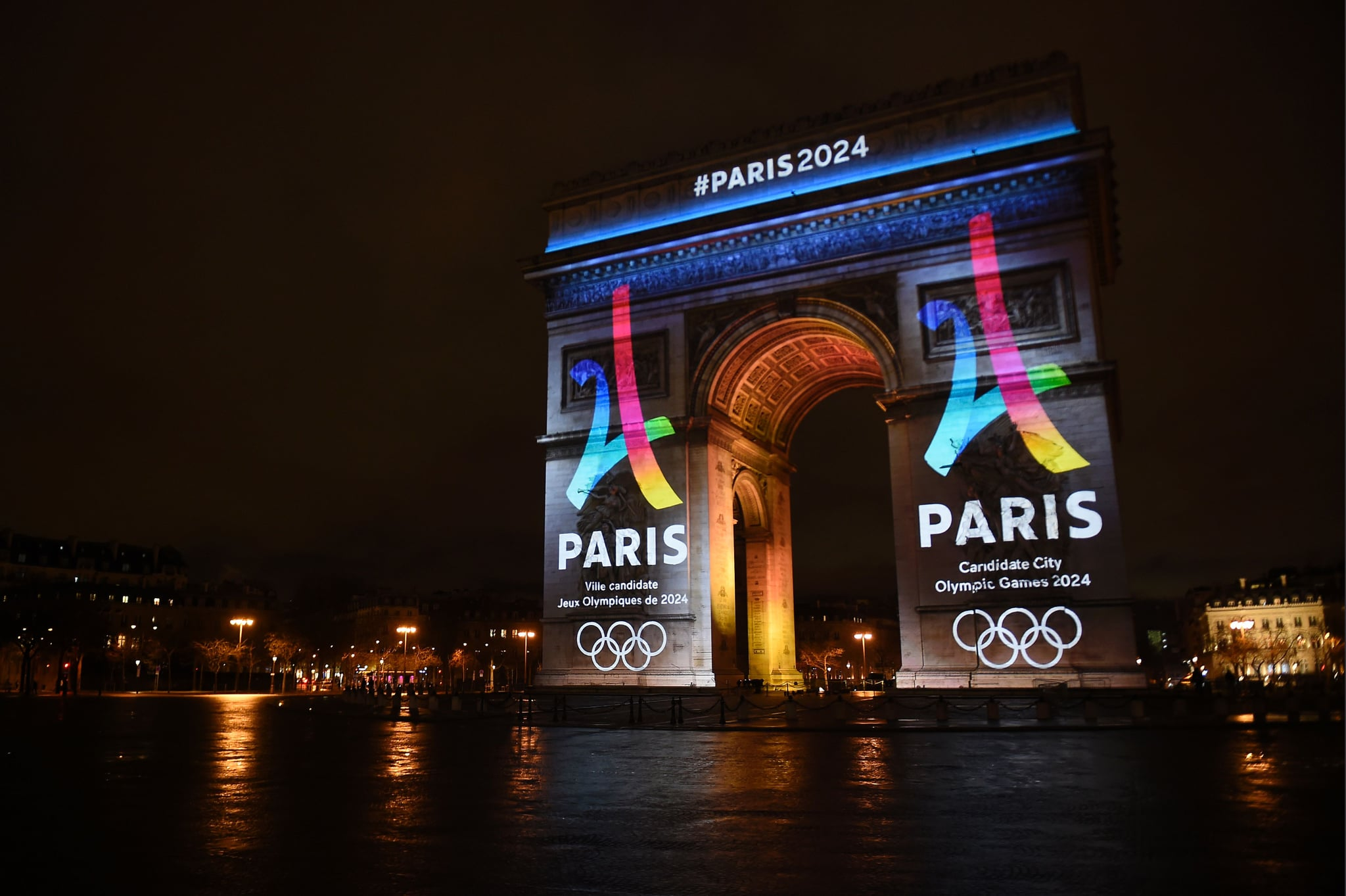 The campaign's official logo of the Paris bid to host the 2024 Olympic Games is seen on the Arc de Triomphe in Paris on February 9, 2016.  AFP PHOTO / LIONEL BONAVENTURE / AFP / LIONEL BONAVENTURE        (Photo credit should read LIONEL BONAVENTURE/AFP via Getty Images)