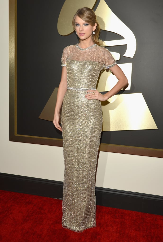 Taylor Swift looked as gorgeous as ever when she arrived at the 2014 Grammy Awards in LA in a Gucci gown. The singer has a big night ahead of her, as she is up for three big awards — including album of the year — and is also slated to perform during the award show. Taylor is no stranger to the Grammys, having already won seven awards over the past six years. In 2010, at the age of 20, she entered Grammys history books when she became the youngest artist ever to win album of the year for Fearless. Keep clicking for more photos from Taylor's night, and vote on all our Grammy Awards polls here!