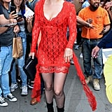 Wearing a Christopher Kane dress and Pleaser boots.