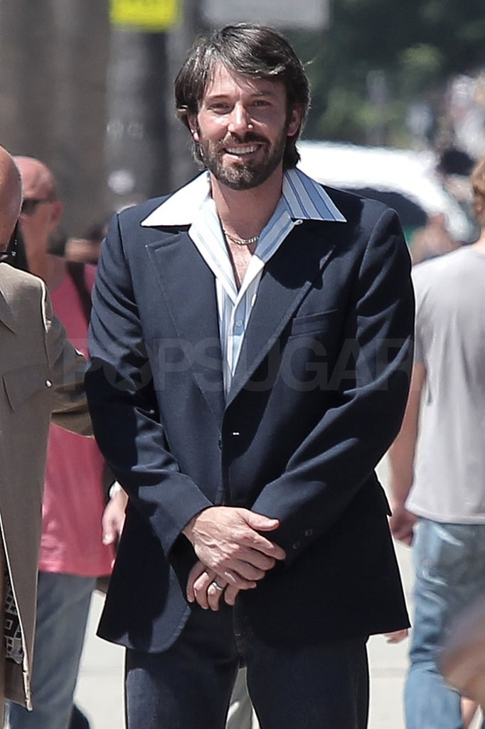 Ben Affleck arrived at a LA studio this morning still modeling a shaggy hairstyle and wearing a purple t-shirt before changing into vintage bell bottoms and a sports coat. He's been spotted logging long hours on the set of his latest directing project, Argo, though Jennifer Garner, Violet, and Seraphina have stopped by to deliver hugs. Ben stars alongside Breaking Bad's Brian Cranston in the flick based on the true story of the CIA's successful rescue of six American hostages from Tehran in 1979. Besides his Hollywood projects, Ben's also excited to take the role of dad of three! The Garner-Afflecks announced Jen's pregnancy last month and Jen's since been proudly showing off her bump. Ben's new movie has him juggling responsibilities on and off camera much like The Town, which was a big hit at last year's Toronto Film Festival. He's he's not involved in the 2011 festivities, but Jen may head north for Tuesday night's Canadian premiere of her quirky, dark comedy Butter.