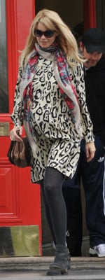 Claudia Schiffer Wearing Leopard Dress and Floral Scarf