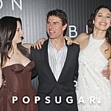 Tom Cruise posed with Andrea Riseborough and Olga Kurylenko, who wore Emilio Pucci, at their Oblivion premiere.