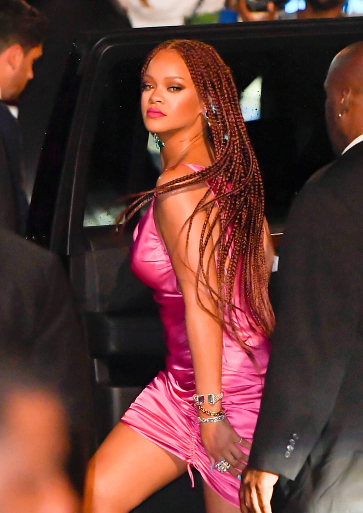 Between the release of her fluorescent Fenty Beauty Summer Collection and the launch of her eponymous fashion line, Rihanna has been busy. Even with her many projects, she still manages to stun fans with striking beauty looks – and her latest is no different.  The entrepreneur and singer stepped out with bright red box braids. She made her appearance with the look before an event promoting her new Fenty collection.  This isn't the first time we've seen Rihanna with the vibrant hair colour. In 2010, the singer had a candy apple red buzzcut, and in 2015, a maroon bob.  Check out Rihanna's new hairstyle, ahead.