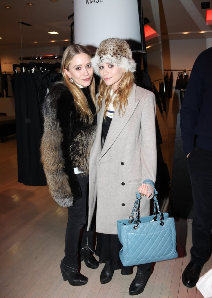 Mary-Kate Olsen in top and fur by The Row, Ashley Olsen in dress by The Row