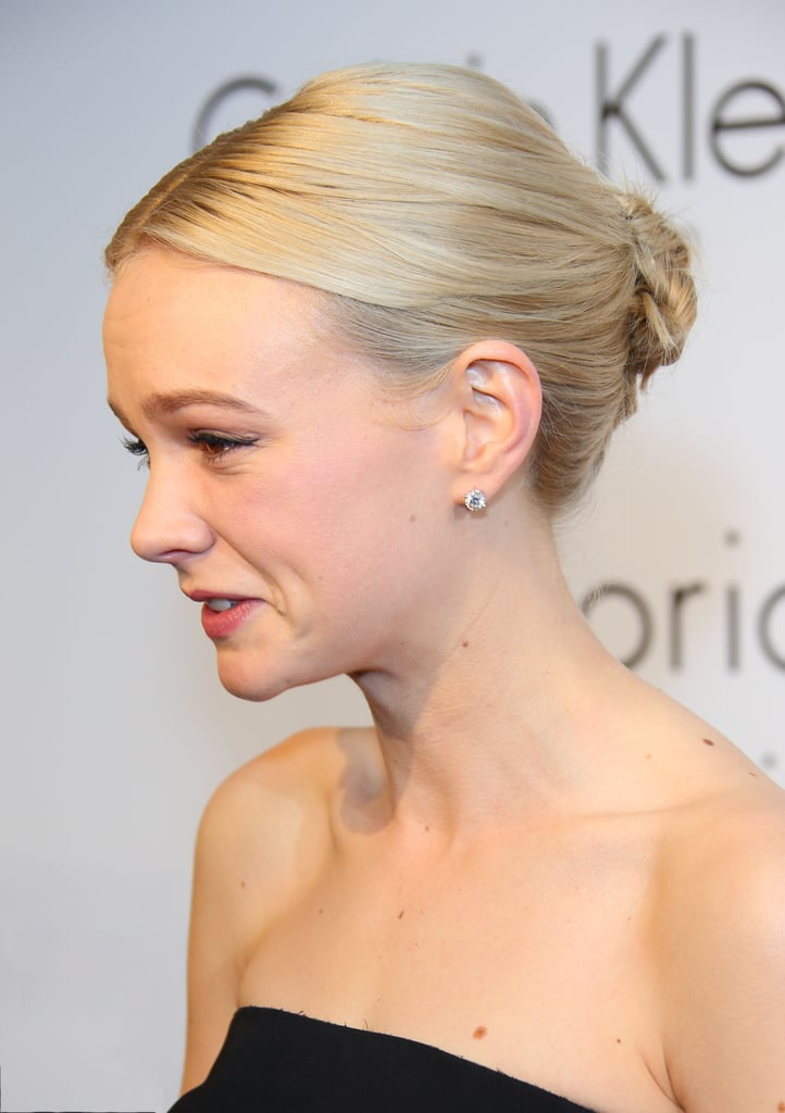 Carey's middle-parted lob was pulled back into a minibun for the Calvin Klein party in Cannes.