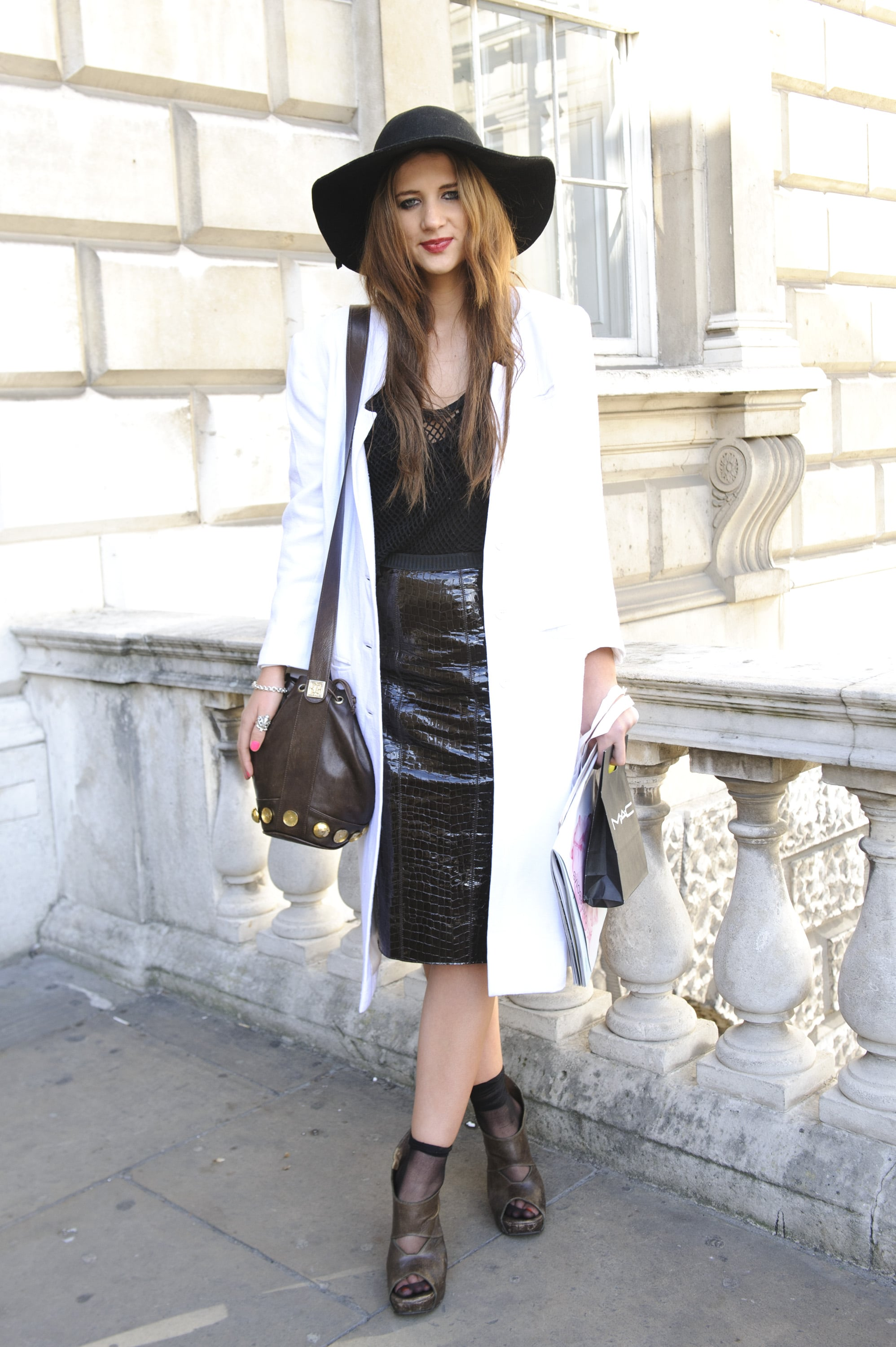 A monochromatic palette gets its slicked-up factor via leather finishes and one cool wide-brimmed hat.
